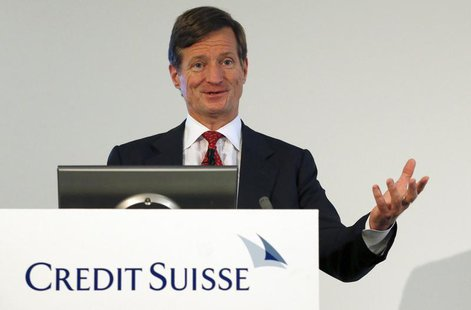 CEO Brady Dougan of Swiss bank Credit Suisse smiles as he addresses a news conference to present the bank's half-year results in Zurich July