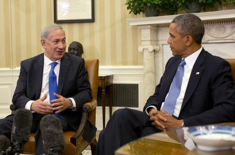 U.S. President Barack Obama listens to Israeli Prime Minister Benjamin Netanyahu in the Oval Office of the White House in Washington, Septem