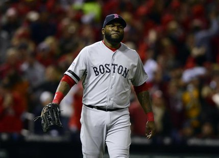 Boston Red Sox first baseman David Ortiz (34) reacts after the St. Louis Cardinals scored 2 runs during the seventh inning of game three of