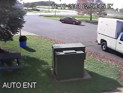 Oshkosh police believe the red vehicle seen in this still frame taken from surveillance video was involved in the theft of cash from a change machine at Planeview Truck Stop, Oct. 17, 2013. (Photo by: Oshkosh Police Department).