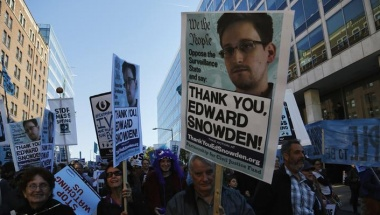 Spanish Protesters carry thank you Edward Snowden signs accusing the  National Security Agency (NSA) of tracking over 60 million calls in Spain in the span of a month, according to reports in Spanish media. REUTERS/Jonathan Ernst