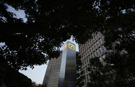 Logos of Deutsche Bank AG are seen in Tokyo September 9, 2013. REUTERS/Toru Hanai
