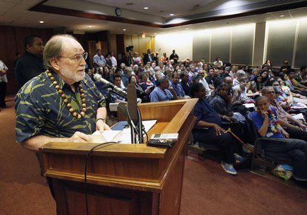 Hawaii Governor Neil Abercrombie reads a quote from the Dalai Lama as he gives testimony in support of same sex marriage during a Senate hea
