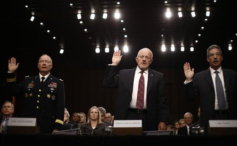 U.S. National Security Agency Director General Keith Alexander (L), Director of National Intelligence James Clapper and Deputy Attorney Gene