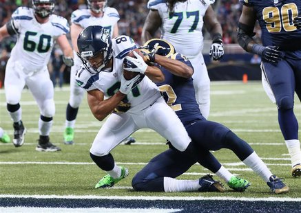 Oct 28, 2013; St. Louis, MO, USA; Seattle Seahawks wide receiver Golden Tate (81) catches a pass for a touchdown defended by St. Louis Rams