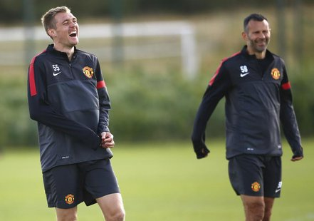 Manchester United's Darren Flectcher (L) laughs during a training session at the Carrington complex in Manchester, northern England, Septemb