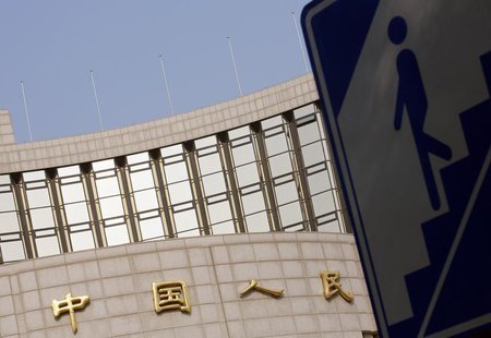 A sign showing the entrance to an underway passage is seen outside the headquarters of the People's Bank of China, the central bank, in Beij