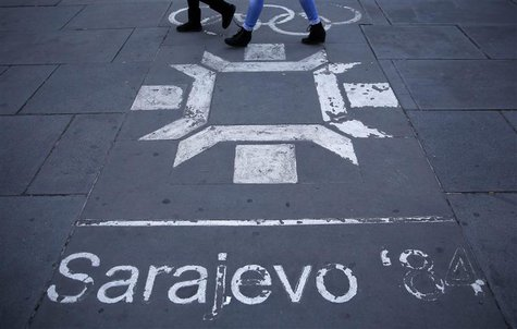 People walk past the logo of the Winter Olympics in Sarajevo, painted on the streets in central Sarajevo October 27, 2013. REUTERS/Dado Ruvi
