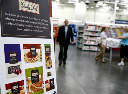 "Customers shop next to a sign advertising ""Daily Chef,"" a new proprietary Sam's Club brand, in a Sam's Club store in Bentonville, Arkansas J"
