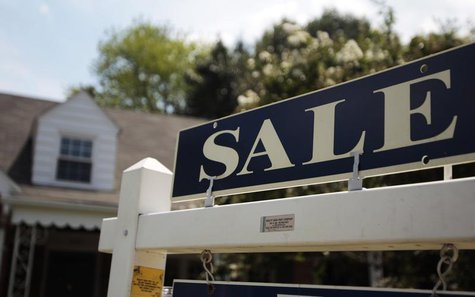 A 'sale' sign is seen outside a house in Alexandria, Virginia in this July 22, 2010 file photo. REUTERS/Molly Riley/Files