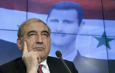 Qadri Jamil, Syria's deputy prime minister for economic affairs, listens during a news conference in Moscow, August 21, 2012. REUTERS/Maxim