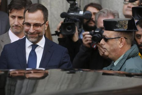 U.S. ambassador in Spain, James Costos (L), leaves the foreign ministry after being summoned to a meeting with Spain's European Secretary of