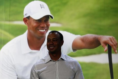 World number one golfer Tiger Woods smiles during a promotional event at the Venetian Macao in Macau October 29, 2013. REUTERS/Bobby Yip
