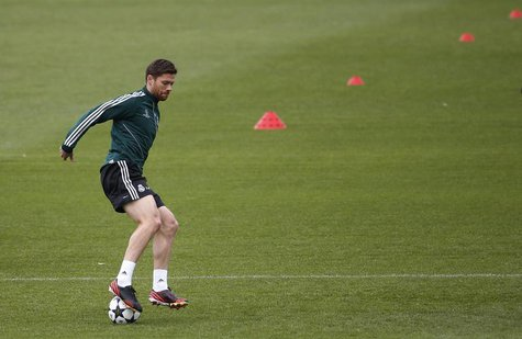 Real Madrid's Xabi Alonso controls the ball during a training session on the eve of their Champions League semi-final second leg soccer matc