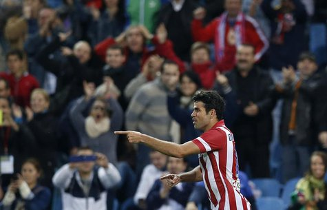Atletico Madrid's Diego Costa celebrates his goal during their Spanish first division soccer match against Betis at Vicente Calderon stadium