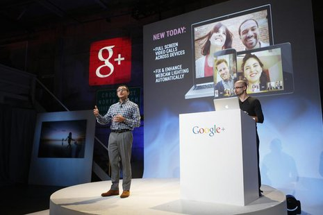 Senior Vice President of Engineering at Google Vic Gundotra (L) speaks about updates to Google Plus during a Google event in San Francisco,