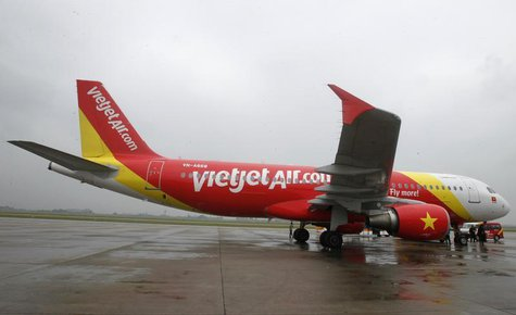 A VietJet A320 airplane is seen while parking before departure for Bangkok, at Noi Bai international airport in Hanoi September 25, 2013. RE