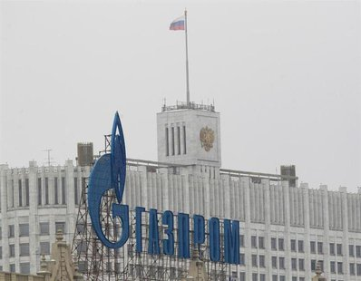 The company logo of Russian natural gas producer Gazprom is seen on an advertisement in front of the White House in Moscow February 8, 2013.