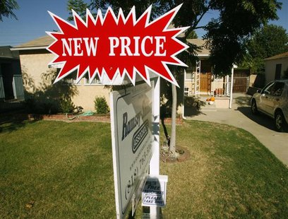 A real estate sign, which indicates the 'new price', stands outside a three-bedroom and one-bath home in Burbank, California October 9, 2007