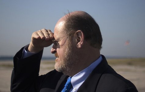 Republican New York City mayoral candidate Joe Lhota looks towards the shoreline during a visit to the Breezy Point, Queens beach community