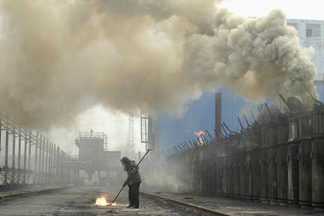 A labourer works at a coking plant in Changzhi, north China's Shanxi province, July 7, 2007. REUTERS/Stringer