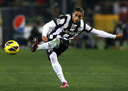 Juventus' Martin Caceres kicks the ball during his Italian Serie A soccer match against AS Roma at the Olympic stadium in Rome February 16,
