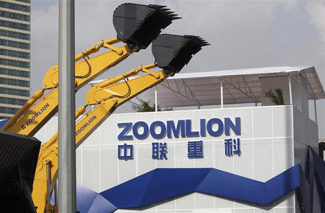 A Zoomlion company logo is seen next to its excavators at an exhibition in Shanghai, in this November 29, 2012 file photo. REUTERS/Stringer/
