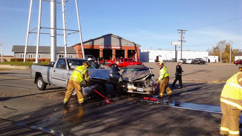 Fire crews clean up a 3 car crash outside the Schofield Fire Department, October 28 2013