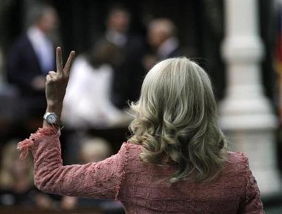 Texas state Democratic Senator Wendy Davis votes against a motion to table an amendment to Senate Bill 1 (SB1) as the state Senate meets to consider legislation restricting abortion rights in Austin, Texas, July 12, 2013. Credit: Reuters/Mike Stone