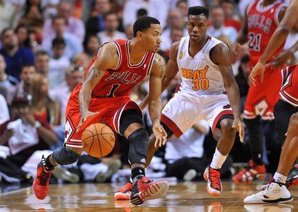Oct 29, 2013; Miami, FL, USA; Chicago Bulls point guard Derrick Rose (1) is pressured by Miami Heat point guard Norris Cole (30) during the