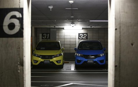 Honda Motor's Fit subcompact hybrid cars are parked in a basement garage at the company's headquarters in Tokyo October 30, 2013. REUTERS/Is