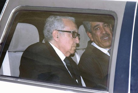 United Nations Peace Envoy for Syria Lakhdar Brahimi (L) sits in a car as he leaves a hotel in Damascus October 28, 2013. REUTERS/Khaled al-