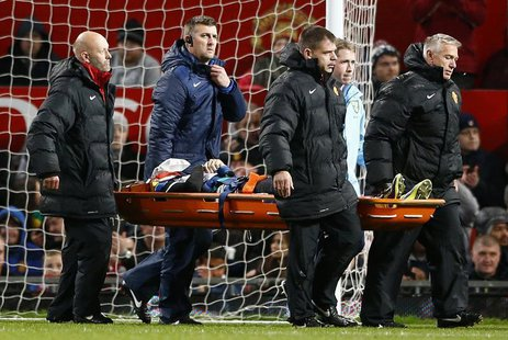 Norwich City's Robert Snodgrass is stretchered off during their English League Cup fourth round soccer match against Manchester United at Ol