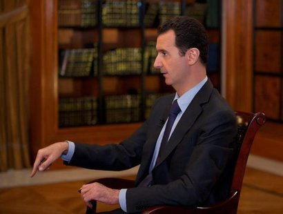 Syria's President Bashar al-Assad speaks during an interview with al-Mayadin television station, in Damascus, in this handout photograph dis