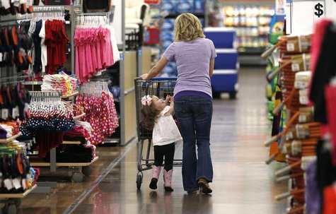 A woman shops with her daughter at a Walmart Supercenter in Rogers, Arkansas June 6, 2013. REUTERS/Rick Wilking