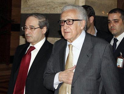 United Nations Envoy Lakhdar Brahimi (C) returns to a hotel after meeting Syria's President Bashar al-Assad in the Syrian capital Damascus O