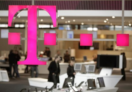 The sign of Deutsche Telekom AG is pictured at its stand for the upcoming CeBIT fair inside a hall in Hanover March 1, 2009. REUTERS/Hanniba