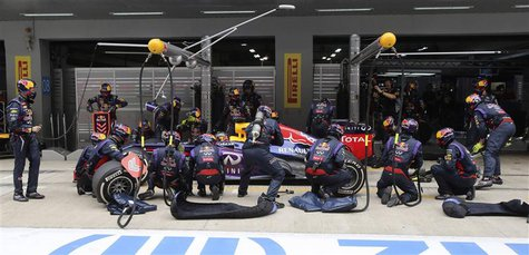 Red Bull Formula One driver Sebastian Vettel of Germany performs a pit stop during the Indian F1 Grand Prix at the Buddh International Circu