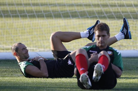 Bulgarian national soccer team players Martin Petrov (L) and Stiliyan Petrov attend a training session in the town of Pravets, some 40km (25