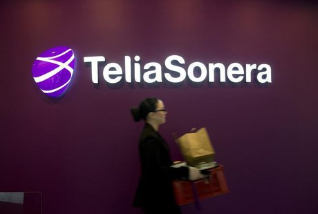 A woman walks past TeliaSonera's logo during the company's fourth quarter result presentation January 31, 2013 in this picture provided by S