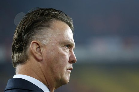 Netherlands' coach Louis Van Gaal looks at his players before the 2014 World Cup Group D qualifying soccer match against Turkey at Sukru Sar