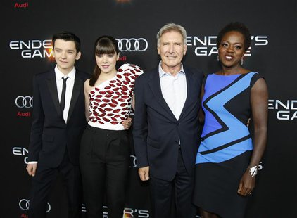 "Cast members Asa Butterfield (L-R), Hailee Steinfeld, Harrison Ford and Viola Davis pose at the premiere of ""Ender's Game"" at the TCL Chines"