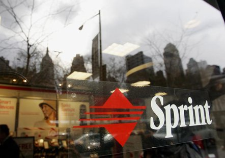 A Sprint logo with a Manhattan skyline reflected in the window on the front door of the Sprint store on New York City's West 42nd street Dec