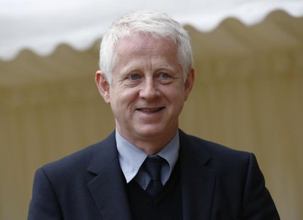 Director Richard Curtis arrives for a reception for the British Film Industry held by Britain's Queen Elizabeth and Prince Philip at Windsor