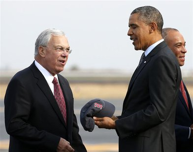 U.S. President Barack Obama is given a Red Sox baseball cap by Boston Mayor Thomas Menino upon his arrival in Boston October 30, 2013. REUTE