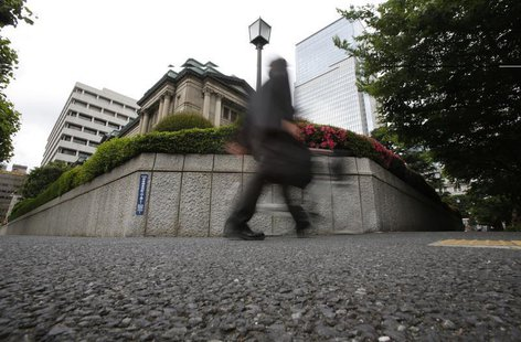 A man walks past the Bank of Japan building in Tokyo May 29, 2013. REUTERS/Yuya Shino