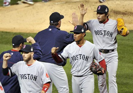 Oct 28, 2013; St. Louis, MO, USA; Boston Red Sox relief pitcher Koji Uehara (right, back) celebrates with Boston Red Sox manager John Farrel