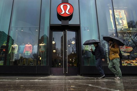 Pedestrians walk past a Lululemon Athletica store in New York, March 19, 2013. REUTERS/Lucas Jackson