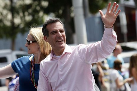 Los Angeles Mayor-elect Eric Garcetti waves to the crowd with his wife Amy Elaine Wakeland during the 43rd annual LA LGBT Pride Parade in We