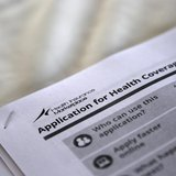 The federal government forms for applying for health coverage are seen at a rally held by supporters of the Affordable Care Act, widely refe